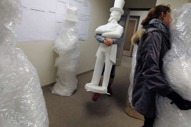 Twenty-one Uncle Sam statues are brought into the Troy BID office after they were delivered and briefly lined up on River Street on Thursday Feb. 7, 2013 in Troy, N.Y. The statues will be decorated by local artist and set up around the city of Troy. (Lori Van Buren / Times Union) Photo: Lori Van Buren