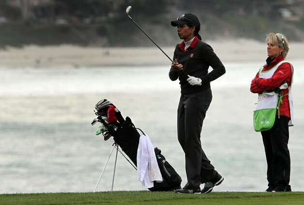 Condoleezza Rice prepares to hit her second shot on the 8th hole at Pebble Beach Golf Links in front of her caddie Kathryn Imrie, the assistant women's Golf Coach at Stanford University during opening rounds of the AT&T Pebble Beach Pro-Am golf tournament on Thursday, Feb. 7th, 2013, in Pebble Beach, Calif. Photo: Lance Iversen, The Chronicle