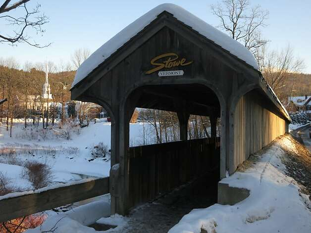 A covered bridge in Stowe village is itself covered by snow in a quintessential New England scene. Photo: Margo Pfeiff, Special To The Chronicle