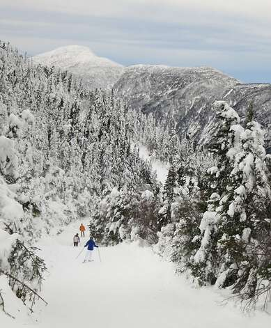 Skiers navigate a snowy run at Smuggler's Notch. Photo: Margo Pfeiff, Special To The Chronicle