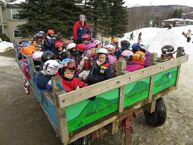 A class of the snowboarders of tomorrow heads off to lunch in a tractor-pulled wagon. Many Vermont resorts are kid-friendly. Photo: Margo Pfeiff, Special To The Chronicle