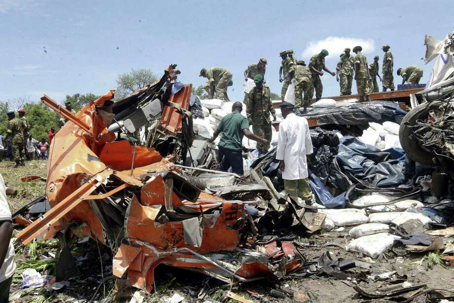 Military personnel search for bodies after a Zambia Postal Service bus collided with a truck near the town of Chifamba, about 60 miles north of Lusaka, the capital. Photo: Salim Dawood / Associated Press