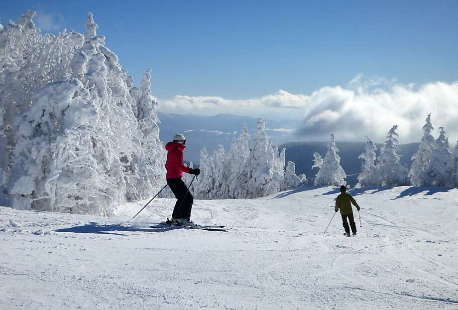 Skiers take off from the top of Mount Mansfield at Stowe Mountain Resort, Vermont's second-largest ski center, on a sunny post-blizzard day. Photo: Margo Pfeiff, Special To The Chronicle