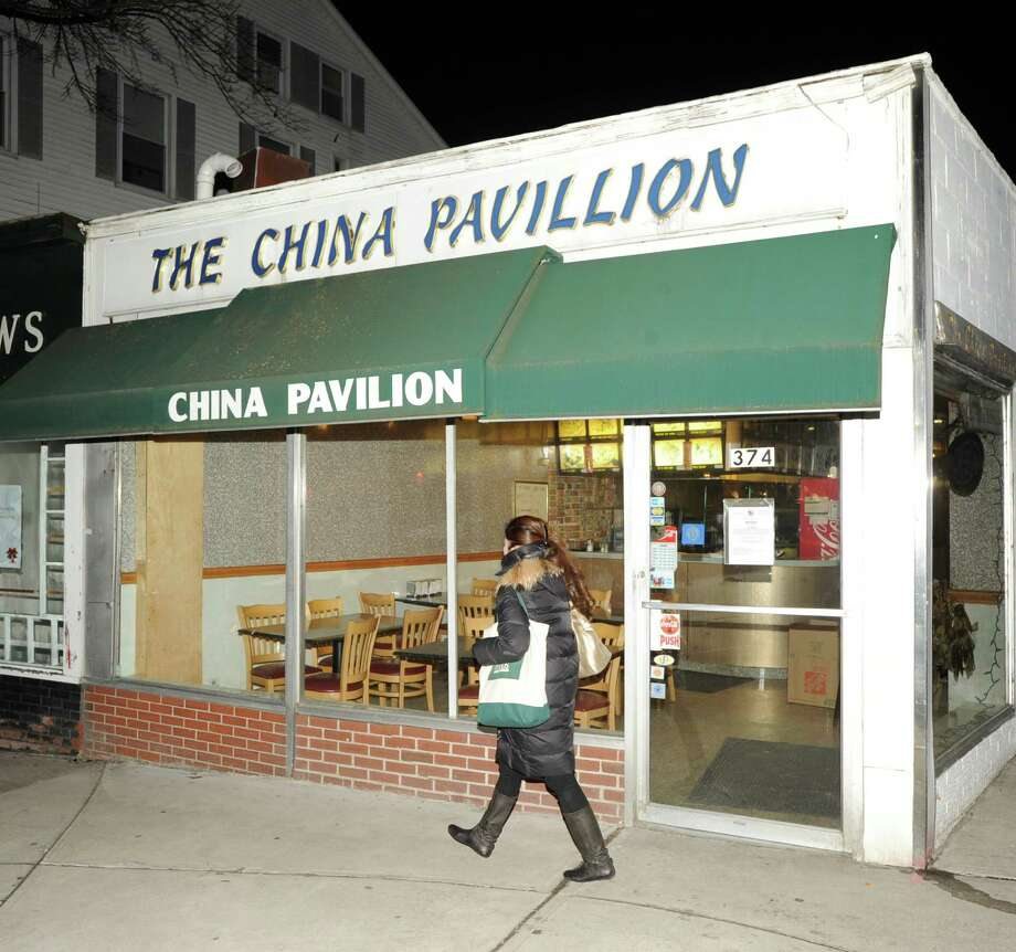 A woman walks past the China Pavilion restaurant at 374 Greenwich Ave., Thursday, Feb. 7. 2013. The restaurant has been closed by the Greenwich Health Department. Photo: Bob Luckey / Greenwich Time