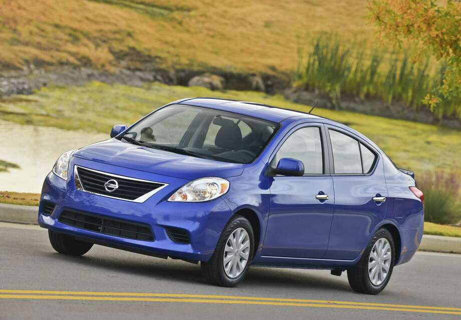 The 2013 Nissan Versa sedan offers a decent ride and a surprisingly roomy cabin for real adults, even in the rear seat. The trunk is spacious as well, and fuel economy is wallet-friendly. Photo: Nissan