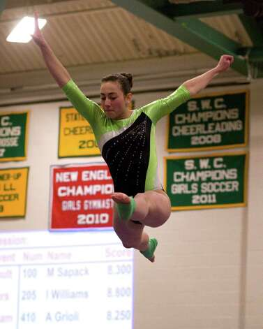 New Milford's Alison Profeta competes on the balance beam during the SWC Gymnastics Championships Thursday night at New Milford High School. Photo: Barry Horn / The News-Times Freelance