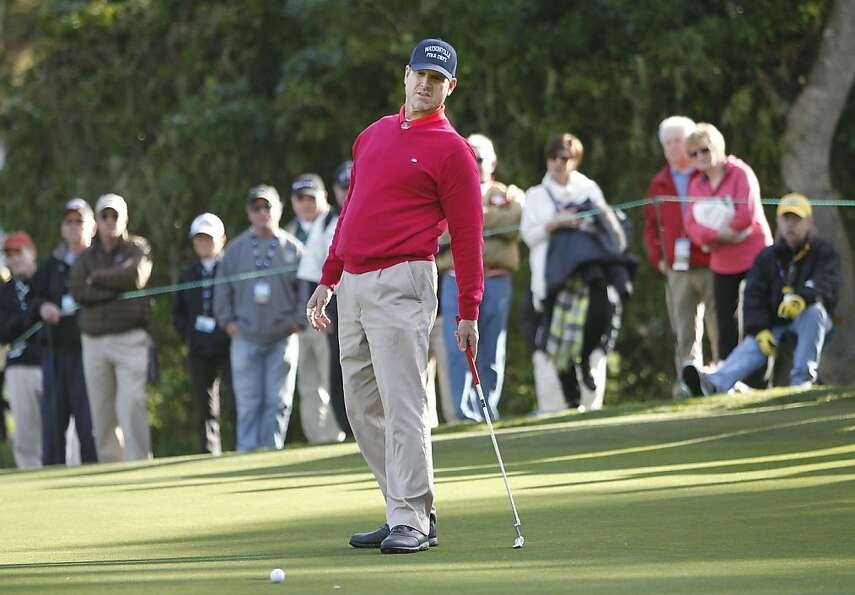 Jim Harbaugh, after just missing at the Super Bowl, just misses a birdie on No. 2.