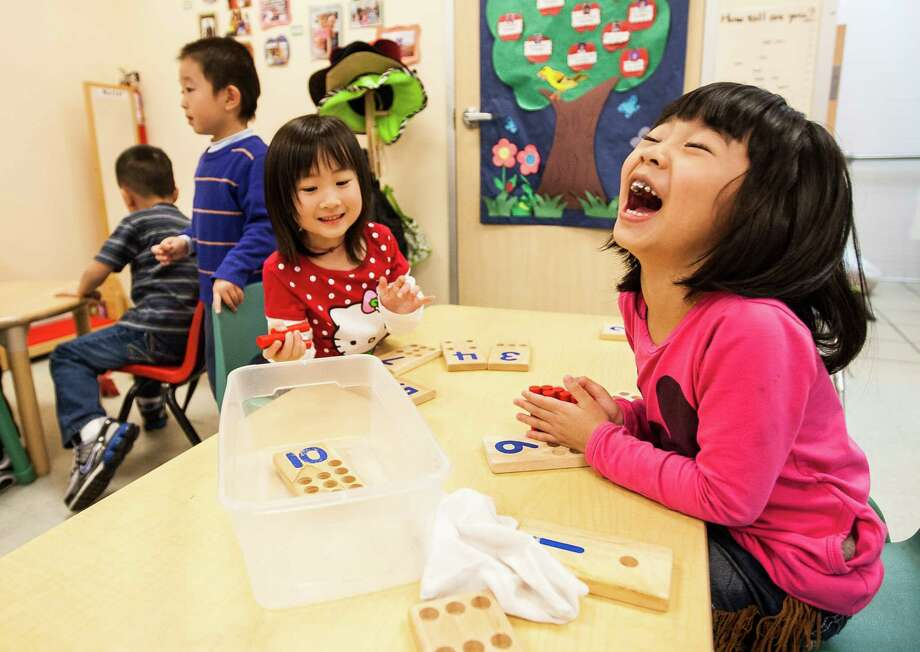 At the Chinese Community Center here, English is a key goal for kids like Jaylynn Takayesu, 5, right, and others. Photo: Nick De La Torre, Staff / © 2013 Houston Chronicle