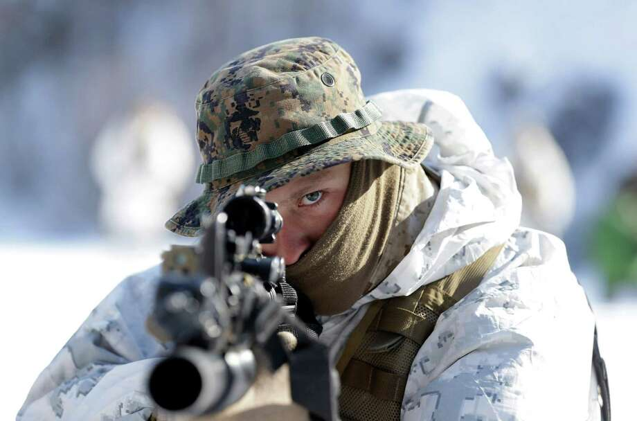 An unidentified U.S. Marine from 3-Marine Expeditionary Force 1st Battalion from Kaneho Bay, Hawaii, aims his gun during their joint military winter exercise with South Korean counterparts in Pyeongchang, east of Seoul, South Korea, Thursday, Feb. 7, 2013. Photo: Lee Jin-man, Associated Press / AP