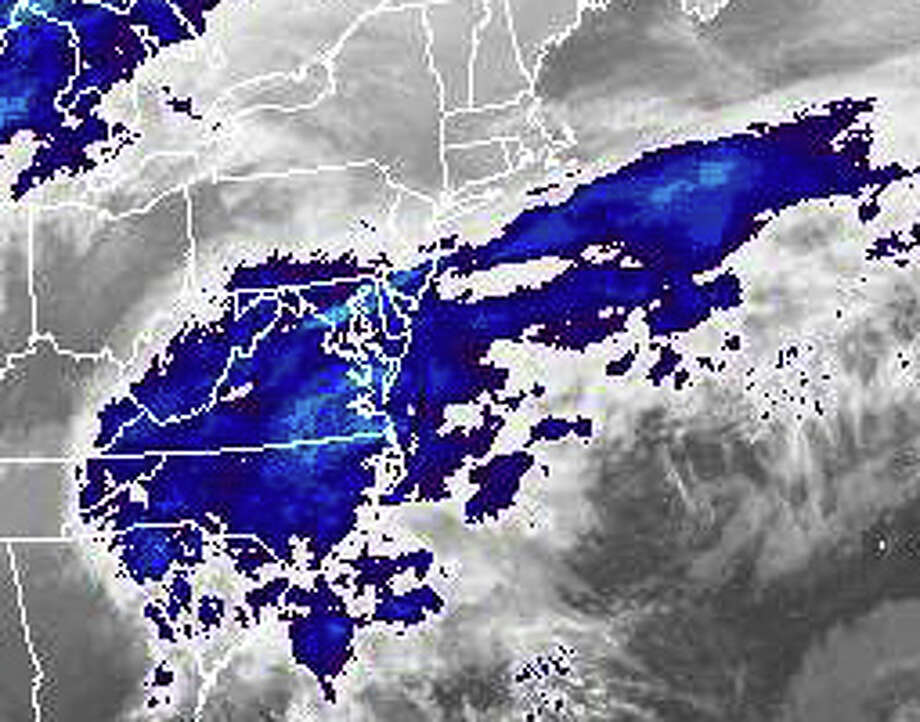 A satellite image shows the gathering storm systems expected to join into a massive nor'easter winter storm that will sweep across southwestern Connecticut with heavy snow and high winds from Friday into Saturday. The image, provided by the National Oceanic and Atmospheric Administration, shows the storm systems about 8:30 p.m. Thursday. Photo: National Oceanic And Atmospheric / Westport News contributed