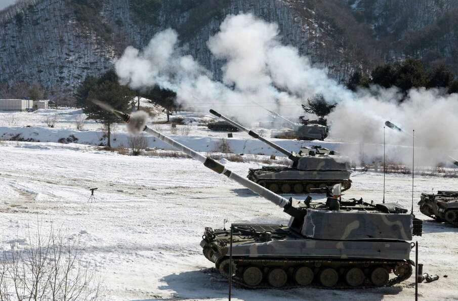 South Korean Army's K-9 self-propelled howitzers fire during a military drill against possible attac