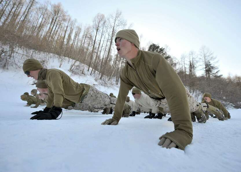 US Marines warm up during a joint winter drill in Pyeongchang, some 180 kilometers east of Seoul, on