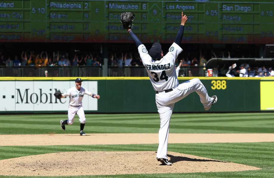 A new contract being negotiated will make Seattle's Felix Hernandez (34) baseball's highest-paid pitcher. Photo: Otto Greule Jr, Stringer / 2012 Getty Images