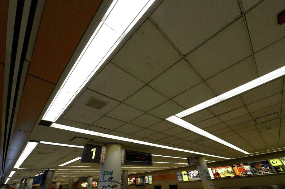 New energy saving lighting shines down on the baggage area of the Albany International Airport this afternoon Feb. 7, 2013 in Colonie, N.Y.  (Skip Dickstein/Times Union) Photo: SKIP DICKSTEIN / 00021072A
