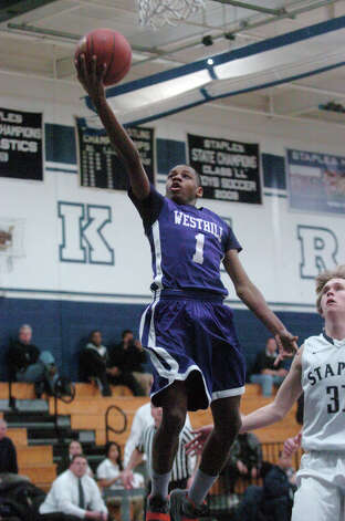 Westhill's Jeremiah Livingston floats to the basket as Staples High School hosts Westhill in a boys basketball game in Westport, Conn., Feb. 7, 2013. Photo: Keelin Daly / Keelin Daly