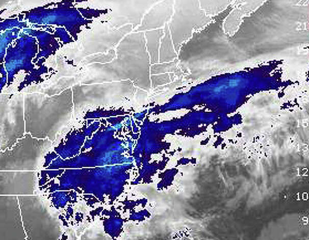A satellite image shows the gathering storm systems expected to join into a massive nor'easter winter storm that will sweep across southwestern Connecticut with heavy snow and high winds from Friday into Saturday. The image, provided by the National Oceanic and Atmospheric Administration, shows the storm systems about 8:30 p.m. Thursday. Photo: National Oceanic And Atmospheric,  National Oceanic And Atmospheri / Fairfield Citizen contributed