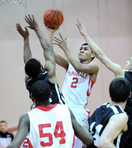 C.J.  Byrd # 2 of Greenwich scores during the boys high school basketball game between Greenwich High School and Trumbull High School at Greenwich, Thursday night, Feb. 7, 2013. In the foreground is Leonel Hyatt # 54 of Greenwich. Photo: Bob Luckey / Greenwich Time