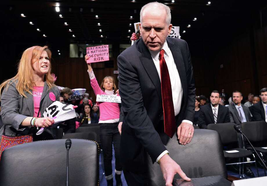 John Brennan arrives at his confirmation hearing during a protest. The demonstrators were upset about CIA drone strikes in Yemen that have killed three U.S. citizens. Photo: Jewel Samad / AFP / Getty Images
