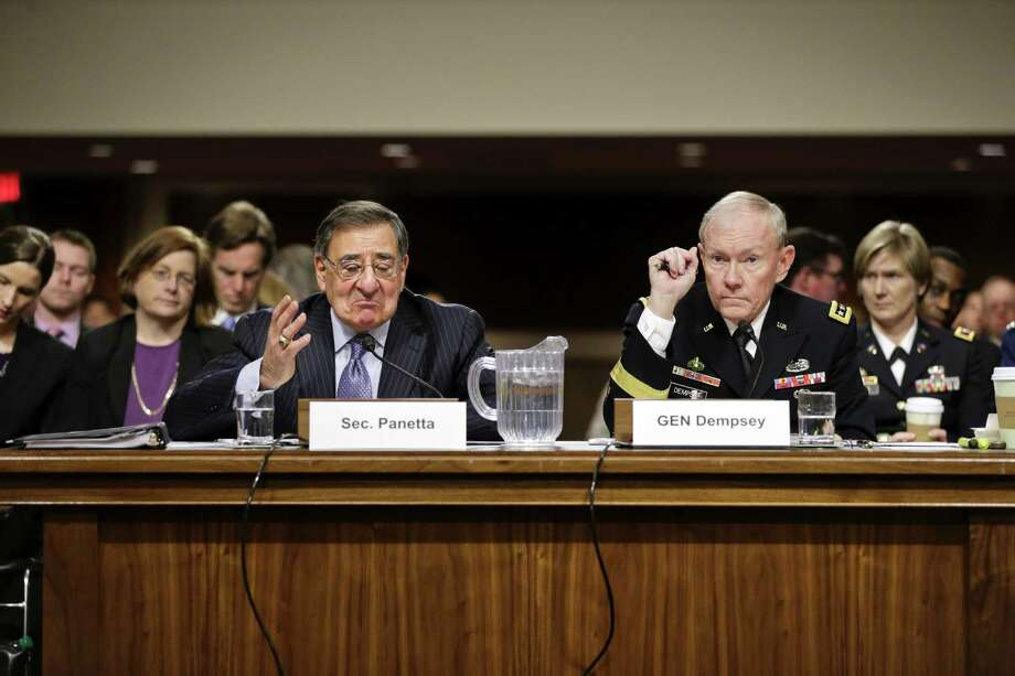 Outgoing Defense Secretary Leon Panetta and Joint Chiefs Chairman Gen. Martin Dempsey testify on Capitol Hill before the Senate Armed Services Committee. Photo: J. Scott Applewhite / Associated Press