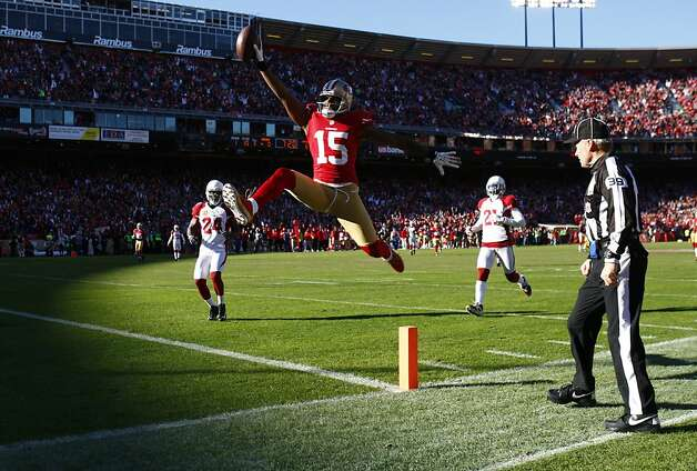 Michael Crabtree catches a touchdown pass thrown by Colin Kaepernick in the endzone during the San Francisco 49ers game against the Arizona Cardinals at Candlestick Park in San Francisco, Calif., on Sunday December 30, 2012. Photo: Carlos Avila Gonzalez, The Chronicle