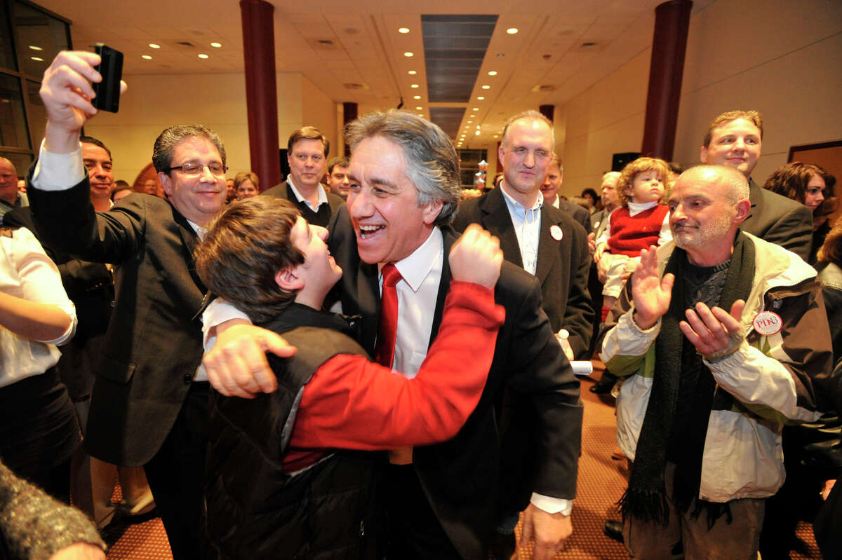 Jerry Pia, a Republican board of education member, hugs Anthony Portanova as Pia is introduced before announcing his candidacy for mayor of Stamford at the Palace Theater on Thursday, Feb. 7, 2013.