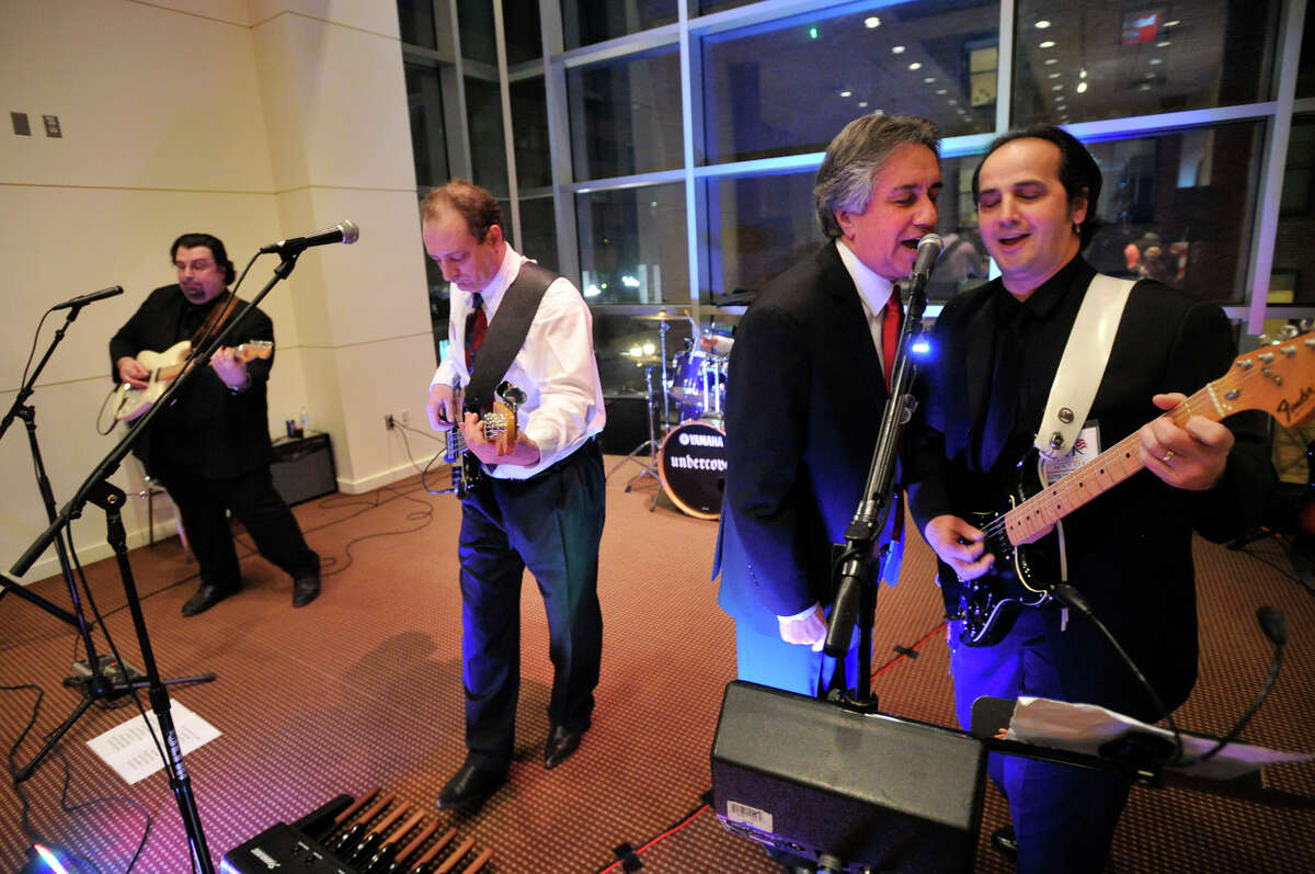 """Republican board of education member Jerry Pia, second from right, sings with Dom Yorfino and the rest of the band, """"Undercover"""" after Pia announced his candidacy for mayor of Stamford at the Palace Theater on Thursday, Feb. 7, 2013."""