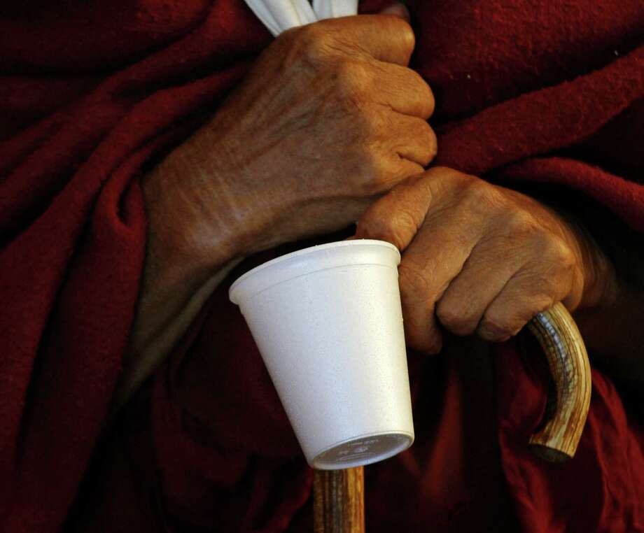 FILE- In this Nov. 30, 2012 file photo, a Tibetan Buddhist monk holds his styrofoam cup as he waits for tea during a religious talk by the Dalai Lama at the Tsuglakhang temple in Dharmsala, India. In an effort to double the city's recycling rate by 2017, New York City Sanitation officials are considering a ban on to-go containers made of polystyrene foam, a material in Styrofoam.  (AP Photo/Ashwini Bhatia, File) Photo: Ashwini Bhatia