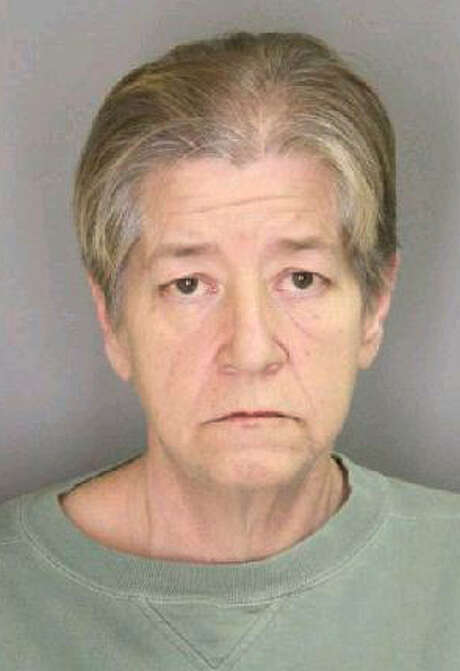 This photo undated provided by the Yates County Sheriff's Office shows in Penn Yan, N.Y., Kimberly Margeson. Margeson has been charged on Tuesday, Feb. 5, 2013 with criminal sale of a controlled substance and promoting prison contraband for passing Oxycodone pills to her incarcerated son as she kissed him during a visit. (AP Photo/Yates County Sheriff's Office) Photo: HOEP / Yates County Sheriff's Office