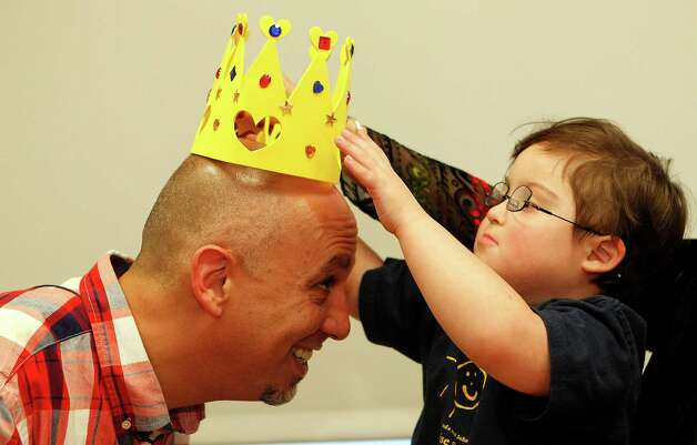 Michael Garcia has a crown placed on his head by Milo Castillo, 5, after students and teachers from The Rise School of Houston honored Garcia for refusing to serve a couple who made a rude remark about Milo.