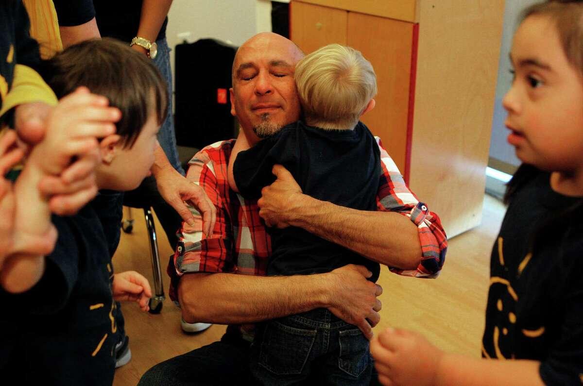 Garcia hugs Milo's classmates.