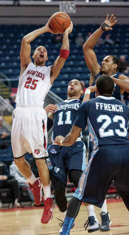 Fairfield University's Colin Nickerson goes up for a shot in a men's basketball game against St. Peter's University played at the Webster Bank Arena, Bridgeport, CT on Thursday February 7th, 2013. Photo: Mark Conrad / Connecticut Post Freelance