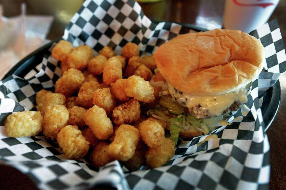 This Wednesday, Feb. 6, 2013 photo shows a hamburger and tater tots at a restaurant in Charlotte, N.C. Deep-fried foods may be causing trouble in the Deep South. People whose diets are heavy on them and sugary drinks were more likely to suffer a stroke, according to a new study released Thursday, Feb. 7, 2013. (AP Photo/Chuck Burton) Photo: Chuck Burton