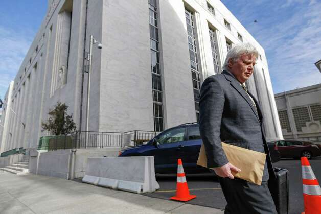 Wayne Longmore leaves the James T. Foley U.S. Courthouse after receiving a sentence that included home detention, probation, a fine and community service,  after he pled guilty to prescribing thousands of addictive painkillers without a legitimate medical purpose,  on Thursday, Feb. 7, 2013, in Albany, N.Y. (Philip Kamrass/ For the Times Herald-Record) Photo: Philip Kamrass / Copyright 2013 Philip Kamrass All Rights Reserved