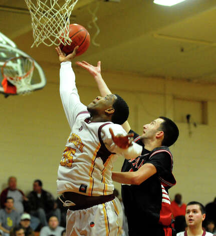 St. Joseph's #35 Erick Langston attempts a shot as Central's #2 Orhan Cecunjanin defends, during boys basketball action in Trumbull, Conn. on Thursday February 7, 2013. Photo: Christian Abraham / Connecticut Post