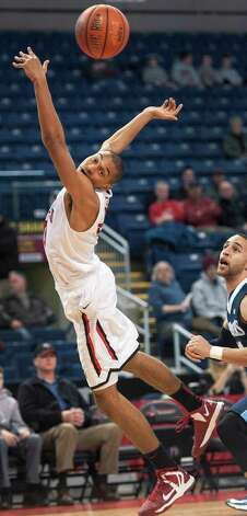 Fairfield University's Marcus Gilbert reaches for a loose ball in a men's basketball game against St. Peter's University played at the Webster Bank Arena, Bridgeport, CT on Thursday February 7th, 2013. Photo: Mark Conrad / Connecticut Post Freelance