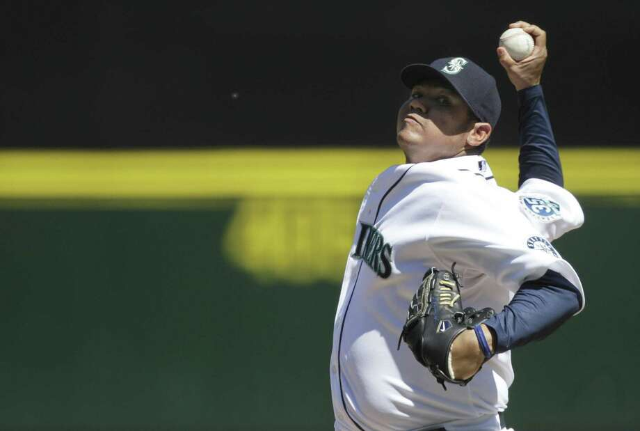 Felix Hernandez and the Mariners are working on a seven-year deal worth $175 million. Photo: Ted S. Warren / Associated Press