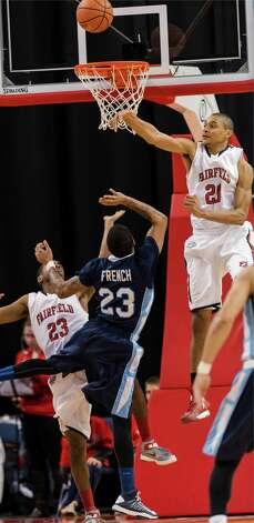 Fairfield University's Marcus Gilbert blocks a shot by St. Peter's University's Blaise Ffrench in a men's basketball game played at the Webster Bank Arena, Bridgeport, CT on Thursday February 7th, 2013. Photo: Mark Conrad / Connecticut Post Freelance