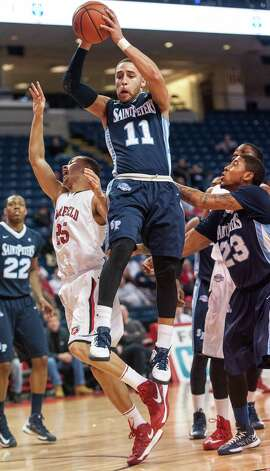St. Peter's University's Desi Washington pulls down a rebound in a men's basketball game against Fairfield University played at the Webster Bank Arena, Bridgeport, CT on Thursday February 7th, 2013. Photo: Mark Conrad / Connecticut Post Freelance