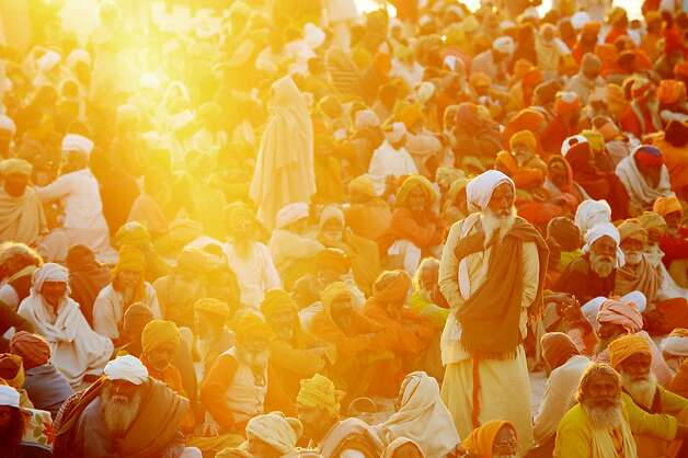 Hindu devotees gather in the shore of the confluence of the Yomuna and the Ganges river at the Sangam in the late afternoon as they wait to be served a free meal organized by an ashram during the Maha Kumbh festival in Allahabad on February 7, 2013. The Kumbh Mela in the town of Allahabad will see up to 100 million worshippers gather over 55 days to take a ritual bath in the holy waters, believed to cleanse sins and bestow blessings.  Photo: Roberto Schmidt, AFP/Getty Images