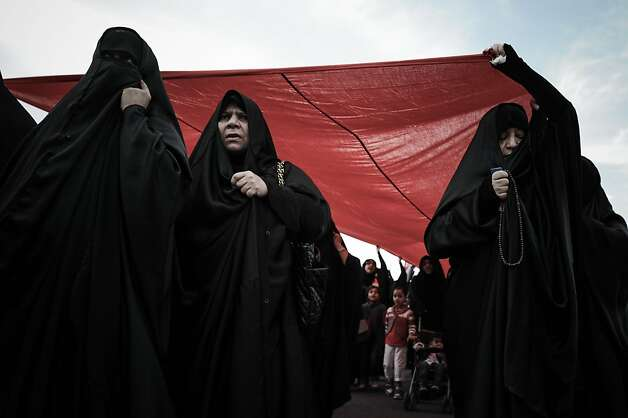 Bahraini women wave a giant national flag during an anti-government rally to demand reforms on February 7, 2013 in the village of Karannah, west of the Bahraini capital Manama. Photo: Mohammed Al-shaikh, AFP/Getty Images