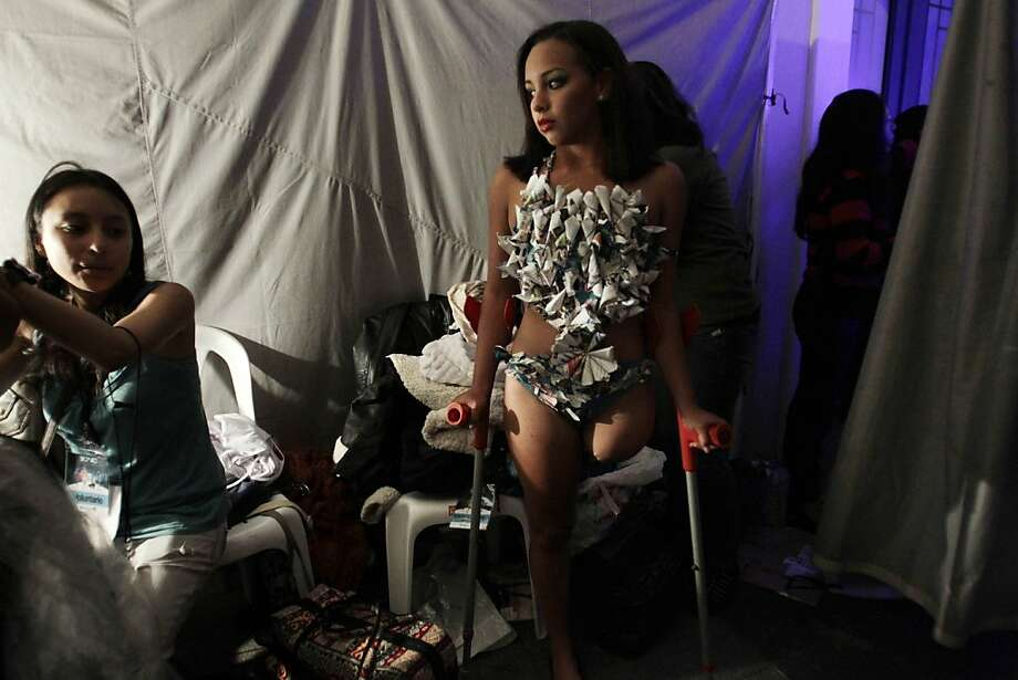 In this Feb, 5, 2013 photo, Arli Mujica, from Venezuela, supports herself on crutches as she wears a piece of her costume before the start of the Bionic Fashion show, backstage at the Metropolitan Cultural Center in Quito, Ecuador. Mujica, a former runner whose whose left leg was amputated due to cancer and uses a prosthetic leg, joined 15 other models from Argentina, Brazil, Bolivia, Costa Rica, Colombia and Ecuador to model creations by Ecuadorian designers at an event organized by the Youth Against Cancer Foundation which aimed to break stereotypes and social barriers for the young cancer survivors. Today, Mujica now swims at the paralympic level.  Photo: Dolores Ochoa, Associated Press