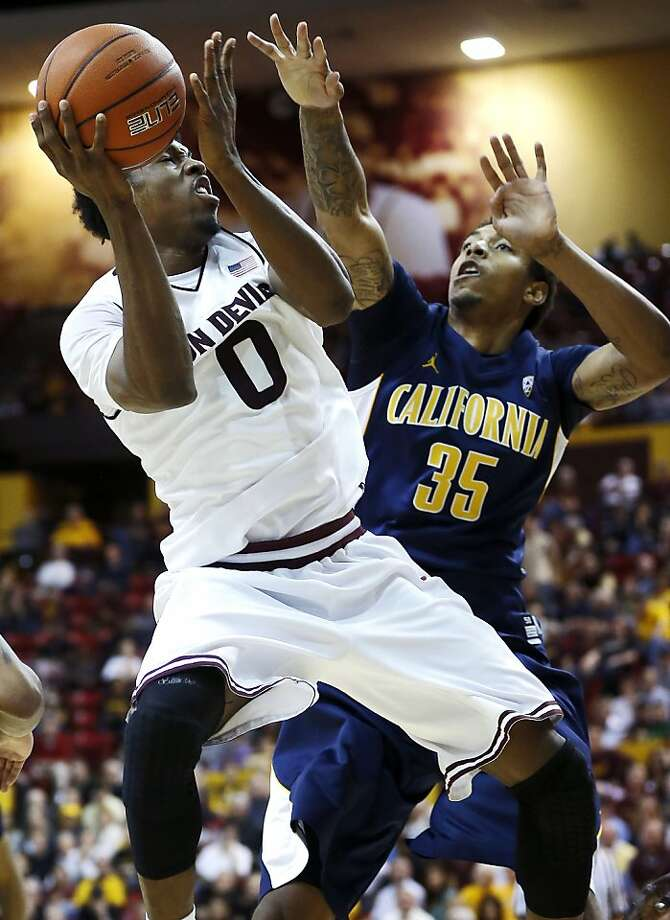 Cal's Richard Solomon tries to stop a first-half shot by Arizona State's Carrick Felix. Photo: Matt York, Associated Press