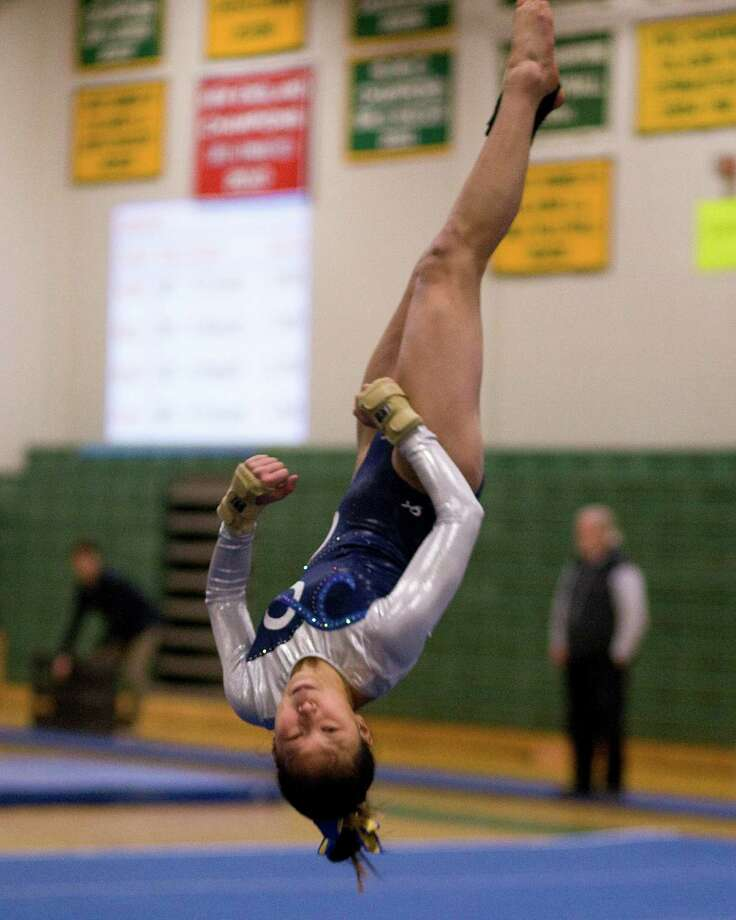 Newtown's Leah Wallace performs her floor exercise routine in the SWC Gymnastics Championships Thursday night at New Milford High School. Photo: Barry Horn / The News-Times Freelance