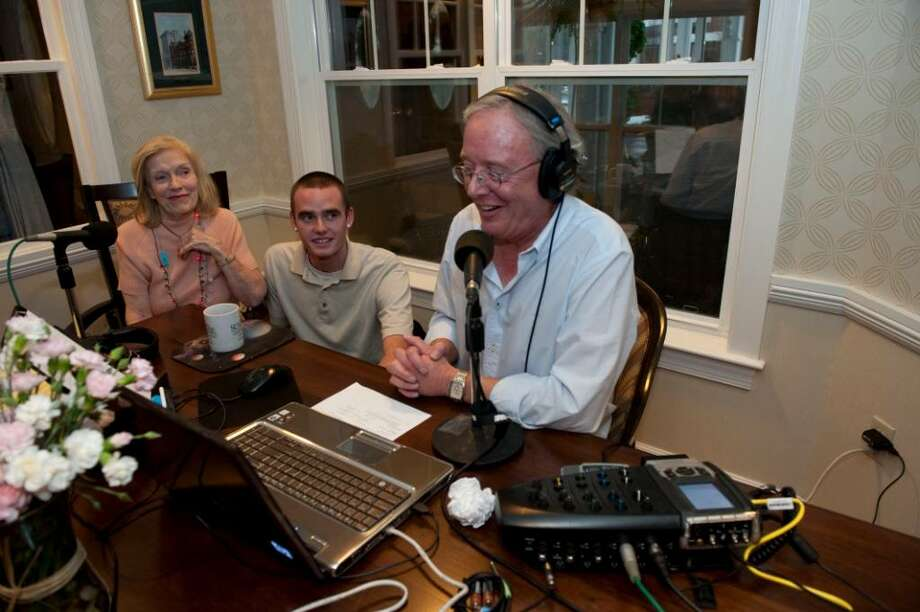 Gary Bergeson, the host of a jazz radio show in California, broadcasts  Saturday Dec. 26, 2009 from Sunrise, with his mother Margaret Bergeson and his son Eric . Margaret lives at the Sunrise assisted living center in Stamford. Photo: Douglas Healey, Douglas Healey/For The Advocate  / Stamford Advocate Freelance
