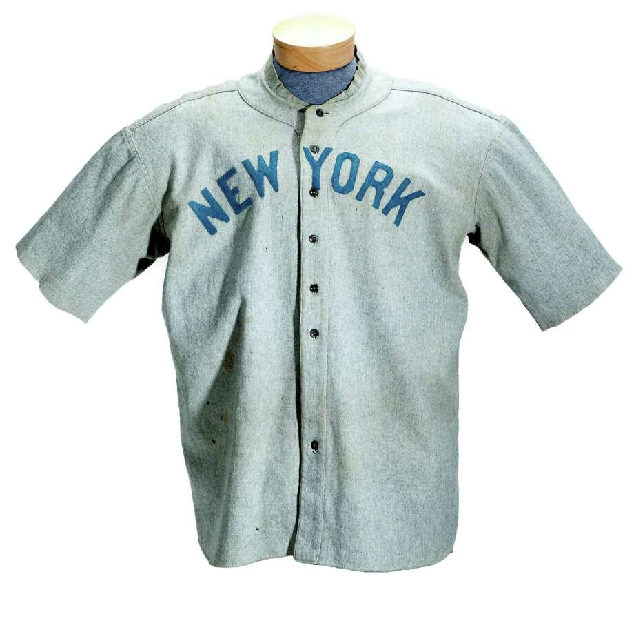 FILE - This undated file photo provided by SCP Auctions shows a circa 1920 New York Yankees baseball jersey worn by Babe Ruth that sold for more than $4.4 million at auction on May 20, 2012. SCP Auctions says the uniform top is the earliest known jersey worn by Ruth and set a record for any item of sports memorabilia. (AP Photo/SCP Auctions, File) Photo: Uncredited