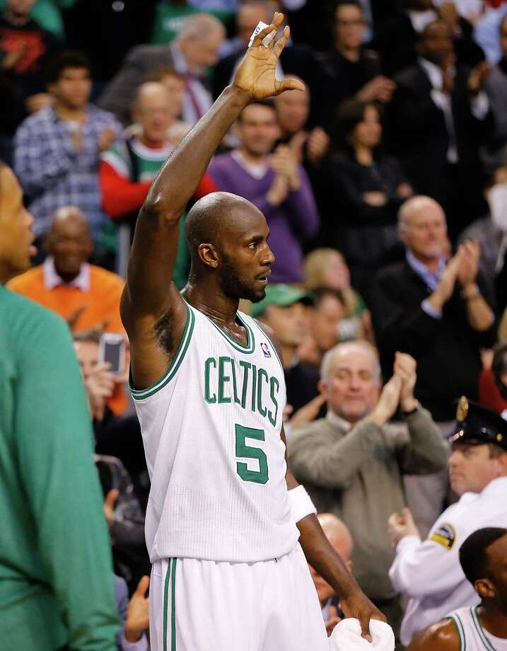 BOSTON, MA - FEBRUARY 7: Kevin Garnett #5 of the Boston Celtics acknowledges the crowd after being recognized for scoring 25,0000 points in his career against the Los Angeles Lakers during the game on February 7, 2013 at TD Garden in Boston, Massachusetts. NOTE TO USER: User expressly acknowledges and agrees that, by downloading and or using this photograph, User is consenting to the terms and conditions of the Getty Images License Agreement. (Photo by Jared Wickerham/Getty Images) Photo: Jared Wickerham