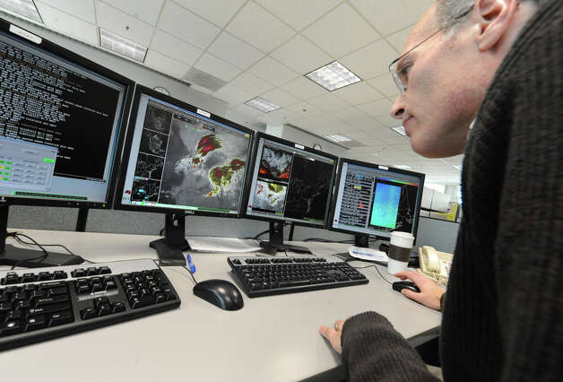 Meteorologist Neil Stuart studies a satellite map, at the National Weather Service, of the massive snow storm heading up the East Coast of the United States on Thursday Feb. 7, 2013 in Albany, N.Y. (Lori Van Buren / Times Union) Photo: Lori Van Buren
