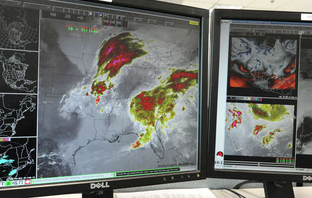 Computer screens, at the National Weather Service, displaying satellite maps of the massive snow storm heading up the East Coast of the United States on Thursday Feb. 7, 2013 in Albany, N.Y. (Lori Van Buren / Times Union) Photo: Lori Van Buren