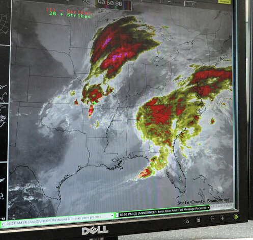 A computer screen, at the National Weather Service, displaying satellite maps of the massive snow storm heading up the East Coast of the United States on Thursday Feb. 7, 2013 in Albany, N.Y. (Lori Van Buren / Times Union) Photo: Lori Van Buren