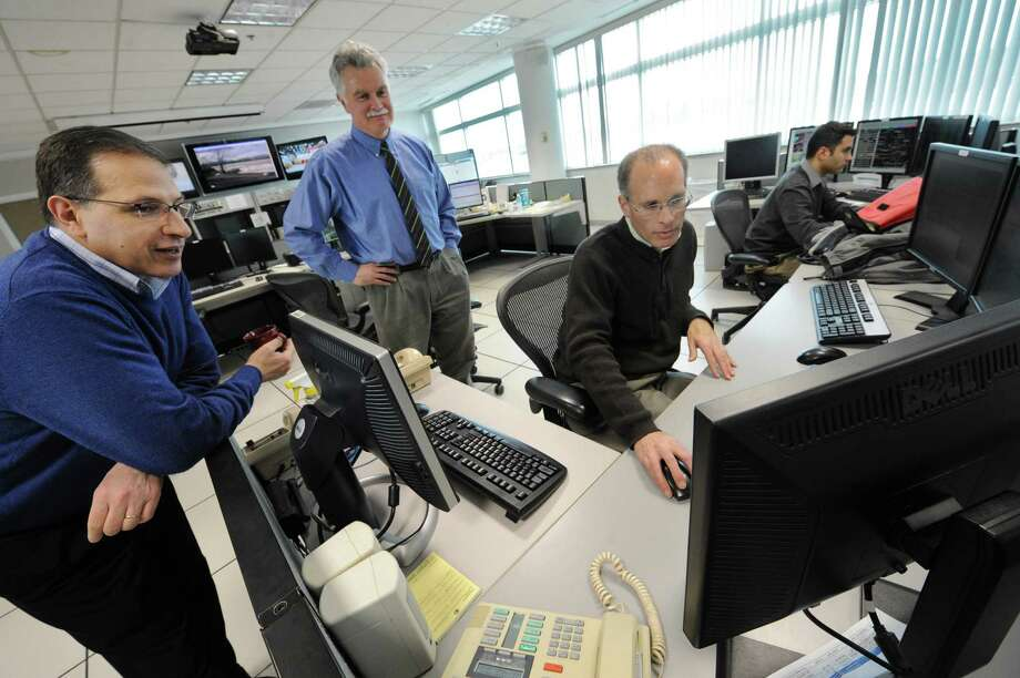 From left, Stephen DiRienzo, warning coordination meteorologist, Ray O'Keefe, meteorologist in charge, and Neil Stuart, meteorologist, watch a satellite map on Neil's screen at the National Weather Service on Thursday Feb. 7, 2013 in Albany, N.Y. A massive snow storm is heading up the East Coast of the United States. (Lori Van Buren / Times Union) Photo: Lori Van Buren